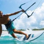 kitesurfing, surfing with a kite,